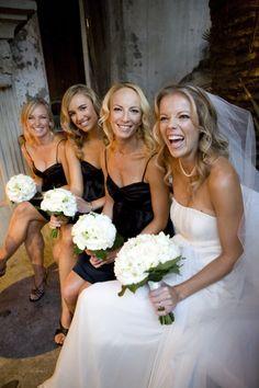 Same coloured white bouquet, black bridesmaid dresses