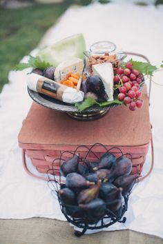 french picnic basket full of cheese, wine and berries - yum