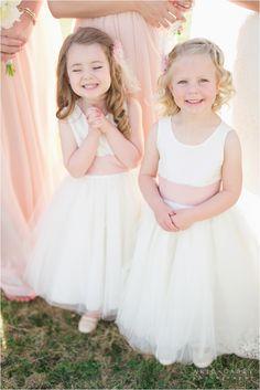adorable flower girls in blush sashes