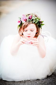 Dreamy little flower girl...love her pouf of tulle and her pretty flower crown.