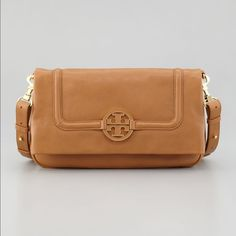 """Tory Burch Amanda foldover Pebble leather with golden hardware. Removable, adjustable crossbody strap; 21"""" drop. Snap outside back pocket. Inside, one zip and two open pockets; canvas lining. 9""""h x 13""""w x 2""""d; weighs approx. 1 lb. 8 oz. Color: TAN Tory Burch Bags Crossbody Bags"""