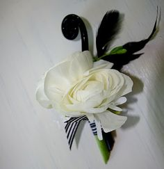 Ranunculus and Fern Curl Boutonniere.    from http://ellabellafloral.blogspot.com/2010/09/jenny-and-ross.html