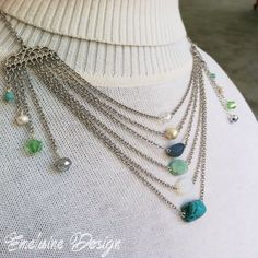 www.facebook.com/EmelaineDesign  Carnival Queen Necklace: featuring turquoise Czech glass, creamy pearls, peridot crystal, mirrored crystal, natural turquoise, moonstone, amazonite, blue quartz, Czech glass pearl, and white crystal on silver chain and findings. Sits at the décolleté. $48, including shipping. #mermaid #carnival #festival #goddess #queen #royal #apparel #accessories #bling #beaded #bridal #bohemian #fashion #gypsy #handmade #jewelry #luxury #mint #ocean #posh #sea  #sparkle