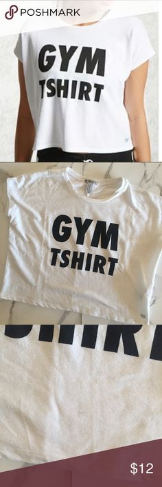 "Forever 21 Gym T-Shirt Worn once. Is an XS but is supposed to fit baggy and loose. Small mark on front bottom but not too noticeable. 60% Cotton, 40% Polyester. Hand wash cold.  Full length: About 19"".  Chest: 21"". Forever 21 Tops"