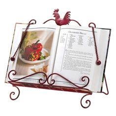 Red Rooster Cookbook Stand: This handy helper will keep your recipe book just where you need it as you put together a scrumptious meal. The decorative metal framework is highlighted by the country rooster at top and features two page keeper chains. Its also a great perch for your tablet. Works with most books and even tablets!