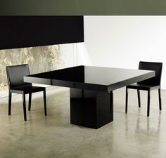 Beech Square Dining Table for Sale features central base and table top in lacquer or wood with colored glass top. Measures 59 x 59 x 30. Seats 8 guests.