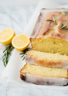 Lemon rosemary yogurt cake - This cake is beautiful as a dessert, a snack with afternoon tea, or even as a breakfast item. Delicious lemon glaze tops the cake. Just Desserts, Delicious Desserts, Dessert Recipes, Yummy Food, Lunch Recipes, Summer Recipes, Food Cakes, Lemon Recipes, Sweet Recipes