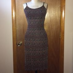 "Alyn Paige Stretchy Glitter Dress Sz 3/4 Alyn Paige stretchy glittery dress - size 3/4. Made in USA. 82% polyester, 12% metallic, 6% spandex. In excellent condition.   Measurements:  Chest: 17"" across the front Waist: 14"" across the front Hips: 17"" across the front Total Length: 37.5"" Alyn Paige Dresses Midi"