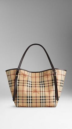 The Small Canter in Haymarket Check from Burberry - A tote bag in coated canvas Haymarket check with leather trim. Inspired by vintage designs, the bag features flat leather straps with stud detail, while the open top closes with a magnetic stay fastening. Discover the women's bags collection at Burberry.com