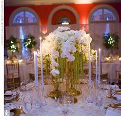 """The palette of the Cameo Ballroom, with its pink walls and antique gold accents, inspired Kelly and Kevin's wedding colors. """"It's the vision of Southern elegance,"""" Kelly says. The guest tables featured low centerpieces of gold compotes filled with pink hy..."""