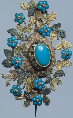 Gorbachev Brooch Russia / St. Petersburg / Hermitage   Brooch depicting a bouquet of forget-me-not created in the     1860s by Piotr Gorbachev (Gorbachev); low purity gold and turquoise.