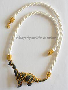 White and Gold Brachiosaurus Dinosaur Wire Wrap Necklace  https://www.etsy.com/uk/listing/188800686/white-and-gold-brachiosaurus-dinosaur?ref=shop_home_active_23
