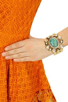 Gold finish turquoise stone bracelet available only at Pernia's Pop-Up Shop.
