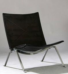 Zwarte PK-22 loungestoel ontworpen door Poul Kjærholm. 190s design
