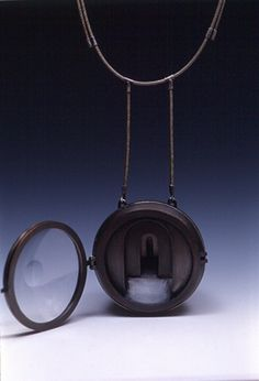"""Labyrinth 1997 copper, silver, watch crystal, steel pendant: 2.5"""" x 2.5"""" x 1""""  Fabricated, die formed. Private Collection. Published in The Metalsmith's Book of Boxes & Lockets, Metalsmith Magazine Summer 2001."""