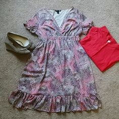 Empire Waist Pink Flutter Dress H&M excellent used condition Sz 12 empire waist pink and gray pattern flutter dress. Length from shoulder to bottom hem 39 inches. Only damage is tag and hanger loops are cut. H&M Dresses