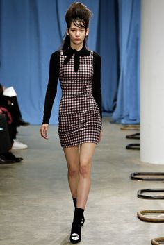 """Adam Selmen Fall 2015 ready to wear was the definition of the 60's. Starting from the beehive hair do's to """"gingham schoolgirl uniforms, polo-collared dresses covered in little bows of yarn, a belted midi dress fashioned after a trenchcoat, accordion-pleated skirts, and matching gloves"""". There were also oversized fuzzy sweaters, rib knits, and bobby socks. 4/6/15"""