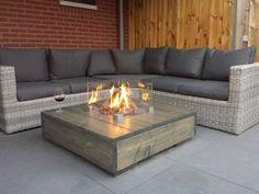Maak uw lounge compleet met deze Loungetafel met tafelhaard