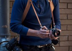 Strap up for wedding season with the dual camera holster and get two times the photography done. This stylish chestnut colored harness is worn in an 'X'...