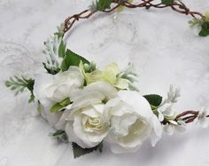 An ivory bridal hair vine adorned with ivory berries, tiny leaves, and a cluster of petite ivory flowers to one side.  Lightweight and comfortable to wear. You can wear it as a headband, with the ends concealed in your hair, or you can order it as a circlet with longer ends so you can tie with ribbons in the back. Select at checkout.  – SIZE: select from drop-down menu – COLORS: ivory / vanilla – MADE TO ORDER, ships in 1-2 weeks. Rush service also available.  –––– SHIPPING / POLICI...