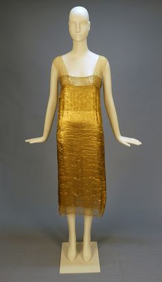 BEADED CHIFFON and GOLD LAME FLAPPER DRESS, 1920's. Sleeveless sage chiffon with V-neck and back with T strap, decorated in a floral pattern of gold beads and sequins studded with coral beads, the skirt having four heavily beaded lame swags. Lame under dress trimmed in gold metallic lace with nude chiffon straps. Under dress
