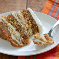 bourbon pecan carrot cake with liquid cheesecake and cream cheese frosting with graham cracker crumbs