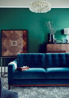 The Puccini Drinks Cabinet, 1,999, Wendy Morrison jewels rug, 595, and Odyssey large sofa, 2,000, all available from John Lewis. Picture credit should read: PA Photo/Handout.