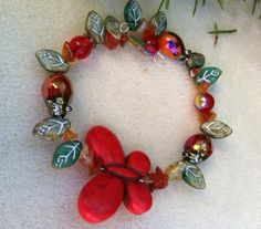 A personal favorite from my Etsy shop https://www.etsy.com/listing/115587791/red-butterfly-garden-bracelet-butterfly