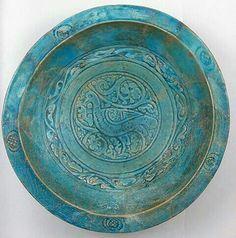 "Iranian bowl.  Bowl Date: 12th century Geography: Iran Culture: Islamic Medium: Stonepaste; carved and glazed Dimensions: H. 3 5/8 in. (9.2 cm) Diam. 13 1/4 in. (33.7 cm) Classification: Ceramics Metropolitan Art Museum"""