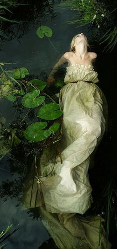 ~floating girl water dress lily pads photograph by an unknown artist (by Benjamin Whitley?) (drowned Ophelia is the subject matter? Fantasy Photography, Underwater Photography, Fashion Photography, Fairy Tale Photography, Photography Ideas, Water Shoot, John Everett Millais, Water Nymphs, Foto Fashion