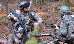 A Latvian soldier and an Afghan soldier communicate during Operational Mentor and Liaison Team training at the Joint Multinational Readiness Center in Germany.