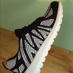 NWT Black and white sneakers Brand new with original box. Super cute, low profile/close fit sneakers. Very breathable mesh material. Could be used as river shoes. Shoes Sneakers