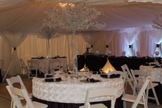 Satin rose backdrop fabric and sparkling glass tree centerpieces