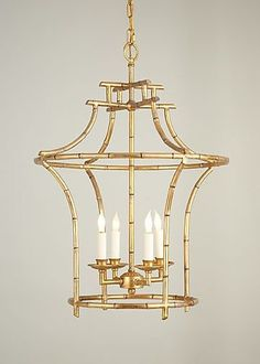 """Our faux bamboo chandelier is a customer favorite!  Charlotte and Ivy loves the antique gold finish and classic style.  The chandelier exudes Chinoiserie-inspired style and the light fixture illuminates rooms with beauty and elegance.  •28""""H x 20.5""""D"""