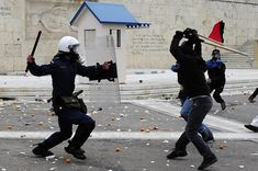 Youths clash with riot police outside the parliament during a demonstration on December 6, 2011, to commemorate the police killing of a student three years ago which sparked violent riots lasting weeks. Pupils and students marched to mark the December 6, 2008 death of Alexis Grigoropoulos, 15, shot by police as Greece first came under pressure from the eurozone debt crisis. AFP PHOTO / ARIS MESSINIS