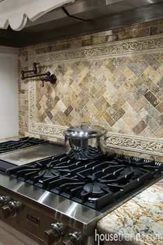 A backsplash comprised of tumbled stone adds to the regal feel of this kitchen and highlights the Viking cooktop. Kitchen Stove, Kitchen Redo, Home Decor Kitchen, Kitchen Backsplash, Kitchen Countertops, Country Kitchen, Backsplash Ideas, Kitchen Ideas, Top Country