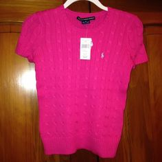 Ralph Lauren hot pink shirt sleeve sweater Hot pink Ralph Lauren short sleeve sweater. Light blue polo pony. New with tags. Never worn. Brand new. Beautiful color Ralph Lauren Sweaters Crew & Scoop Necks