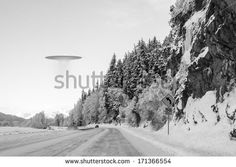 UFO space ship hovering over an Alaskan road in winter with a car in the distance. Unidentified Flying Object, Aliens And Ufos, Business Design, Royalty Free Stock Photos, Canning, Outdoor, Space Ship, Distance, Shape