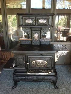 circa 1887 Atlantic Grand Cook Stove with warming bread drawer. Solid cast iron top warming oven.