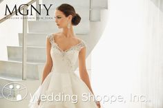 Madeline Gardner  Bridal Gown Nina / 51110, $1350ish organza, Ivory silver, beautiful beading front and back.