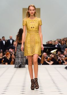 Dark gold hand-woven metallic tape shift dress and The Belt Bag - Oblong in tan leather. Discover the collection at Burberry.com