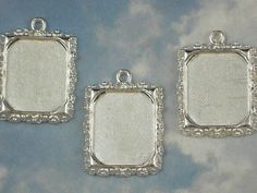 String frames together and put pictures of lost loved ones in the frames, then tie around bride's bouquet… Great way to remember and include those you've lost!  5 Silver Floral Edge Picture Frame Charm Pendants for Resin, Polymer Clay or More (P434)
