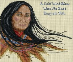 American Indian woman.  I cross stitched this on vinyl-weave 14 count cross stitch fabric for a 3 ring binder cover.