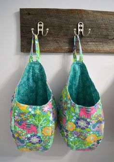 This is a pattern + tutorial for a hanging pod storage basket. These bags are great for stuffing full of grocery bags, tossing in loose toys to get them out of sight, filling with winter-wear like scarves, hats, and gloves, etc. This is a quick and easy project which should take about an hour to complete. This is a great project for beginners!  Materials for this project: 1/2 yard outside fabric 1/2 yard lining fabric sewing thread  Length is approximately 16, circumference around 2...