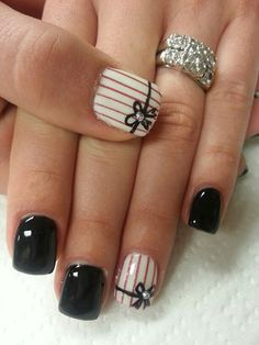 Pretty striped black and white nail art design. Make your nail art stand out with glitter stripes and a thin black ribbon painted across the tips adorned with silver beads on top.