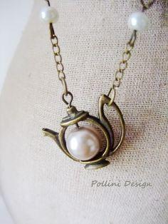 Have a Tea Necklace. Antique Teapot  with Pearl. Pastel (VNL-17). $19.50, via Etsy.