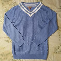 Lightweight cable-knit long sleeve V-neck sweater White Stag cotton/rayon blend, long sleeve cable-knit V-neck sweater. Striped V-neck. Ribbed waistband and cuffs. Approximately 25 inches long. SIZE: Small. Color: Cornflower blue. 60% cotton, 40% rayon. Smoke-free home. White Stag Sweaters V-Necks