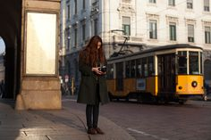 stylish photographing and photographed girl in Milan...you must love the tram!