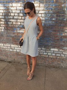 smalltownfancy.com Black and white stripe dress. J.Crew Factory. Louis Vuitton purse. Sam Edleman block heel sandals.