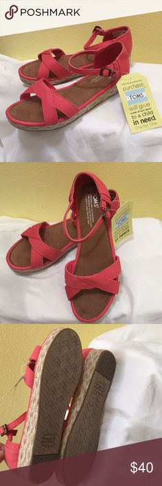 "Toms ladies Sandals If you know Tom's then you know comfort! Pink color with straw platform, approx 1"" heel. New with tags but may show signs of trying on in store. Toms Shoes Wedges"